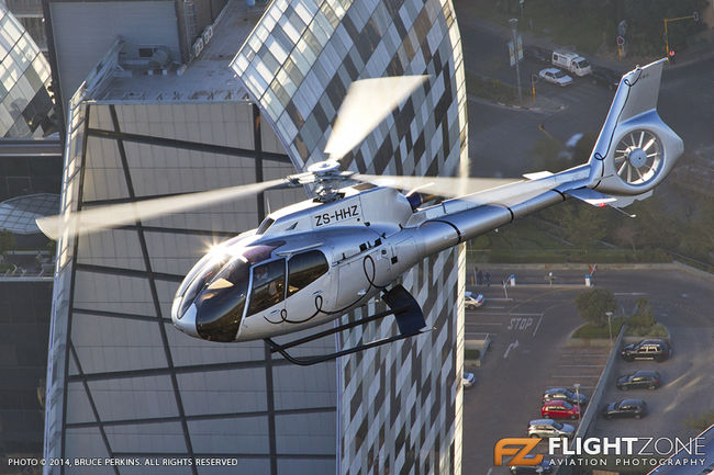 Airbus EC-130 T2 ZS-HHZ over Sandton Eurocopter